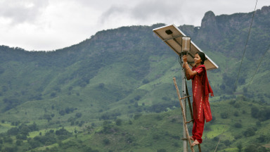 An engineer at the solar-powered village of Tinginapu in India.