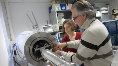 Stéphane Holé (ESPCI Paris) and Adela Marian (IASS) discuss the setup for the space charge tests.