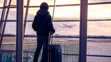 Traveller silhouette at airport