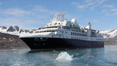A cruise ship skirts the Monacobreen Glacier in Svalbard in the High Arctic. The new accessibility of the Arctic and the opportunities for shipping and tourism associated with that also harbour dangers.