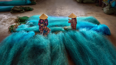 Vietnamese women are repairing fishing nets in a repair shop. Although women are engaged at all levels of interactions with the ocean, gender inequality is not uncommon across sectors.