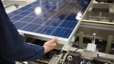 The production of solar panels is increasingly automated but still requires a significant number of workers.